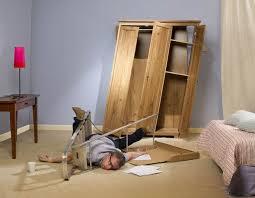 furniture flat pack. a man tangled in flatpack furniture flat pack