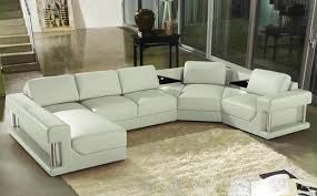 A lovely four piece sectional in white leather. The sides of the sofa have  metal