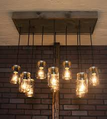 amusing pendant chandelier with mason jar reclaimed wood and red brick wall idea