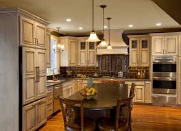 French Cream Antiqued Painted Wood Cabinetry Featuring Espresso Finished  Kitchen Island, Artisan Handmade Tile
