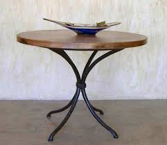 copper top and forged base dining table napa base