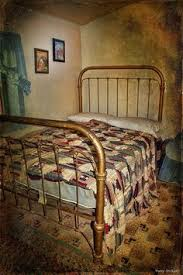 old iron beds. Interesting Iron Iron Bed Frame And Old Handmade Quilt Linoleum On Old Beds E