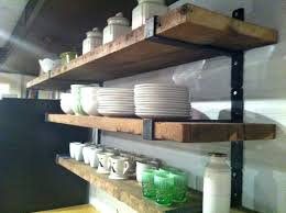 wood shelves with metal brackets wall