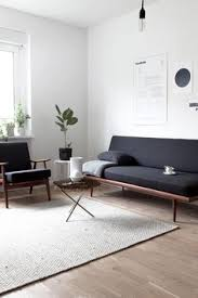 sleek living room furniture. such a sleek living room design love the simple artwork up on wall behind sofa furniture