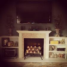 diy fireplace idea for summer get the glow without overheating our fireplace mantelfake fireplace logsfireplace