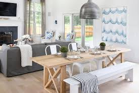 andrew brown interiors blond x based dining table with white tolix chairs view full size