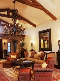 Living Room With Wrough Iron Chandelier And Spanish Style Furniture