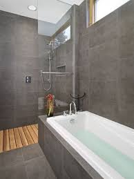 How To Clean Bathroom Floor Extraordinary A Charcoal Tile Bathroom With Cedar Wood For The Shower Floor The