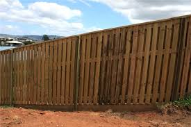 how to build a fence on a slope good neighbour with sleeper base and capping on how to build a fence on a slope
