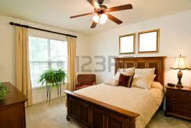 fan for bed. ceiling fan: bedroom with blank frames above bed fan for t