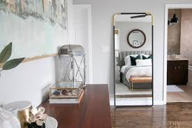 CB2 Black And Brass Full Length Mirror In A Master Bedroom Space