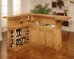 Interior Small Bar Design For Home Designs With Goldenrod Wooden - Home bar cabinets design