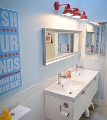 View in gallery Sleek modern kids' bathroom with interesting lighting choice