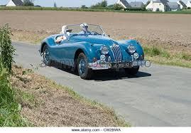 jaguar xk140 stock photos jaguar xk140 stock images alamy jaguar xk140 cabriolet of 1957 in the tour de bretagne near pordic in the cotes d