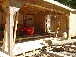 homemade swing blade sawmill. might be a good idea to get one of those electric pressure washers if you skid the logs through dirt. it will really save blade life. homemade swing sawmill l