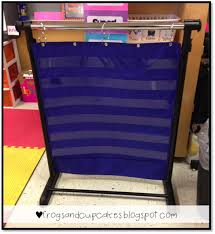 Turn A Garment Rack Into An Adjustable Pocket Chart Stand