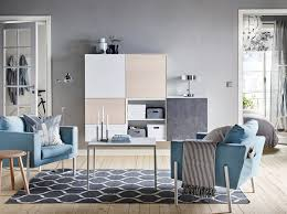 furniture in style. A Calm Blue And Grey Living Room With Two Arm Chairs An Open Furniture In Style T