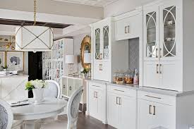 stunning contemporary home office equipped with a snack station is fitted with a white round pedestal dining table surrounded by round french back white and