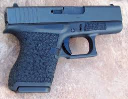 below a glock 43 with 360 hi wrap stip tex stip tex on dust covers and slide plate hi grip cut and mag well beveling