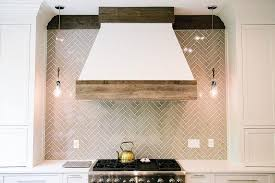 white cabinets with gray glass herringbone tiles