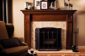 darker staining wood fireplace mantel for wood burning fireplace with metal door a luxurious corner chair