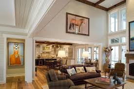 high ceiling family room living rustic with wall art neutral color