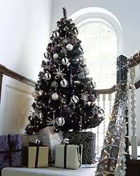 a black tree with white and purple decor looks non-traditional and fresh