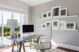 sleek office desk. chrome sawhorse desk next to stacked floating picture ledges sleek office