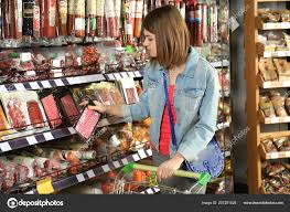 Grocery Store Product List Beautiful Woman With Product List Choosing Fresh Bakery In