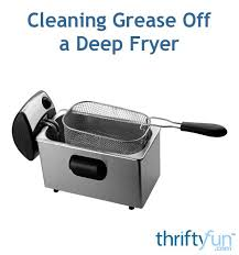 cleaning grease off a deep fryer