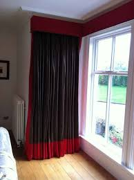 fascinating modern bedroom decoration with black red curtain combine with glass windows also white and red wall paint along with brown parquet floor