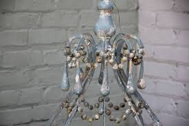 iron and wood beaded eight light painted chandelier with painted drops throughout newly wired