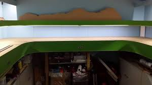 i put led strip lights in place right around the layout the top levels have lights behind the valances attached the top shelves
