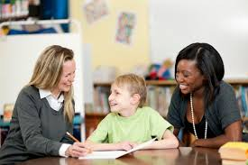 master of education in special education concentration in early boy in wheelchair two teachers at school