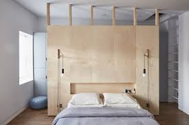 in a brownstone in bedford stuyvesant brooklyn a birch ply wall divides the