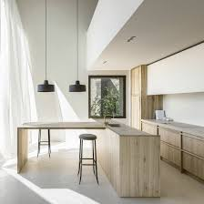 arjaan de feyter bines light and warm materials in converted brewery apartment