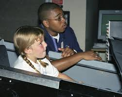 Nicole Schultheiss flies an F/A-18 simulator with NASA engineer Byron  Simpson's coaching during Take Your Children to Work Day June 22 - NASA/Tom  Tschida — Google Arts & Culture