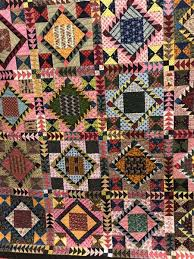 AQS Show in Des Moines & The red and white quilt with the cat was titled Cat -Tastrophy. The  pictorial quilts was by a young man who lives between Taiwan and the US –  they were ... Adamdwight.com