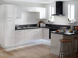 white kitchen cabinets off update laminate with dark floors granite countertops and black appliances brown blue