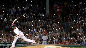 fans shine the lights on their cell phones in the stands as matt barnes pitches at fenway park on june 6 2018 photo by mad meyer getty images