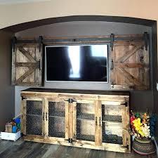barn door tv cover full size of barn door to hide cabinet over fireplace sliding