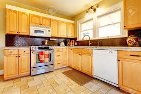 Kitchens With Wood Cabinets Yellow Kitchen With Wood Cabinets And Dark Brown Backsplash Design