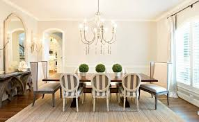 kitchen table centerpiece ideas cream rug round crystal chandelier white fur rug green wall wood floor romantic candles glass candle