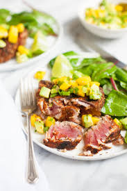 grilled blackened tuna steaks with mango avocado salsa plated
