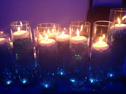 candle lighting ceremony set up underwater light at the base growing blue gel