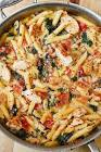 chicken   bacon with penne pasta in a creamy garlic tomato s
