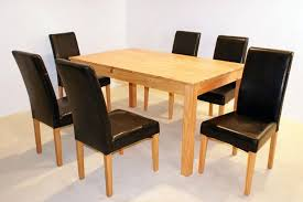 oak dining table for 6 with black vinyl upholstery armless dining chairs set in black and white dining room