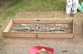 build a raised garden bed. Logs In Raised Garden Bed « Inhabitat \u2013 Green Design, Innovation, Architecture, Building Build A