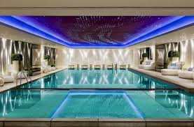 indoor swimming pool lighting. luxurious indoor swimming pool with nice lights lighting