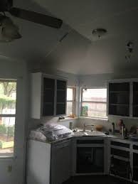 kitchen sink with a sloped ceiling